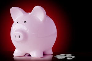 Pink piggy bank with loose change.